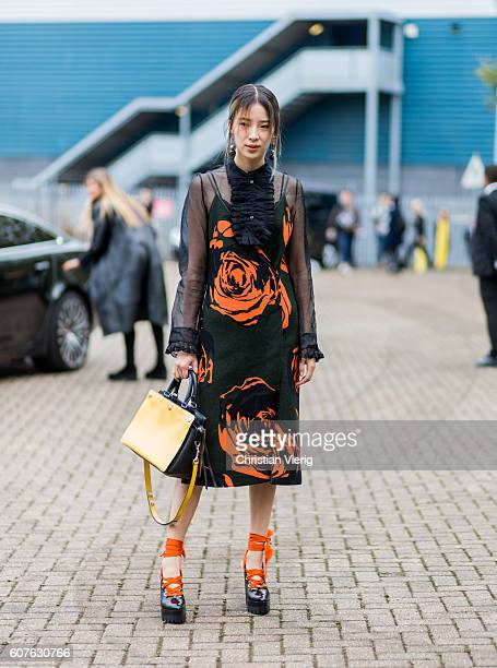 Irene Kum wearing a dress outside Mulberry during London Fashion Week Spring/Summer collections 2017 on September 18 2016 in London United Kingdom