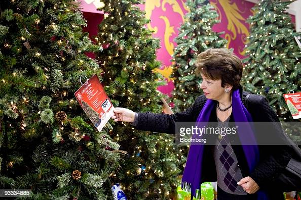 Irene McCreery looks at an artificial Christmas tree on display inside a Home Depot store in New York US on Thursday Nov 19 2009 Home Depot Inc the...