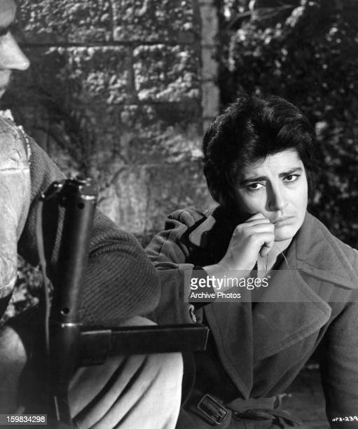 Irene Papas kneeling in sadness in a scene from the film 'The Guns Of Navarone' 1961