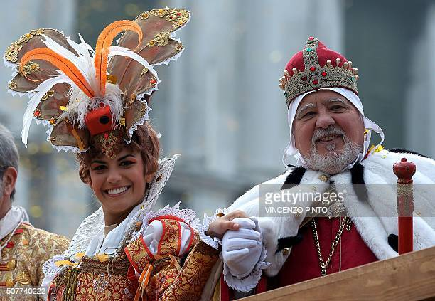 Irene Rizzi poses with an actor dressed as a 'Doge' after performing the 'Angel flight' or 'Flight of the dove' from the bell tower of Saint Mark's...