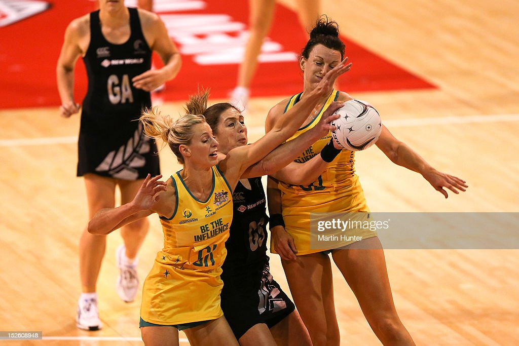 <a gi-track='captionPersonalityLinkClicked' href=/galleries/search?phrase=Irene+van+Dyk&family=editorial&specificpeople=597563 ng-click='$event.stopPropagation()'>Irene van Dyk</a> (C) of New Zealand fights for the ball during the Constellation Cup match between the New Zealand Silver Ferns and the Australian Diamonds at CBS Canterbury Arena on September 23, 2012 in Christchurch, New Zealand.