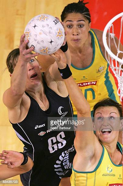 Irene van Dyk of the Silver Ferns and Bianca Chatfield of the Diamonds compete for the ball during game one of the Holden Netball Test Series between...