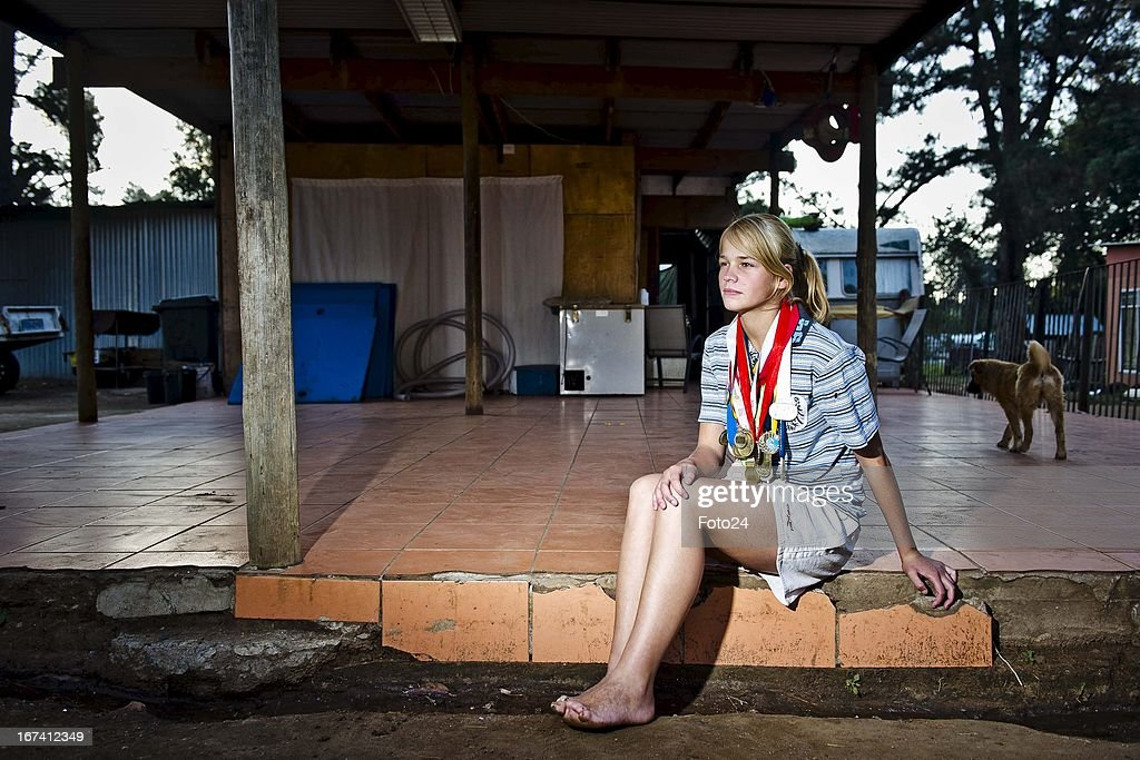 Irene van Niekerk at her home in the Coronation Park Caravan Park on April 24, 2013, in Johannesburg, South Africa. Despite having lost most of her toes when she was accidentally placed in a bath of boiling water as a baby, Irene boasts with a collection of 32 gold medals for various races at school- and provincial level. She runs barefoot, and recently ran a 1500m race in 4:45 - the world record for girls under 15, is 4 minutes.