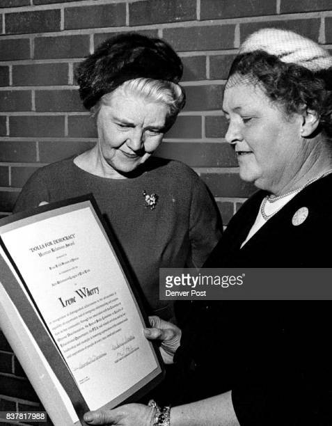 Irene Wherry right receives congratulations on her 'Dolls for Democracy' human relations award from B'nai B'rith women from Miss Mildred Biddick who...
