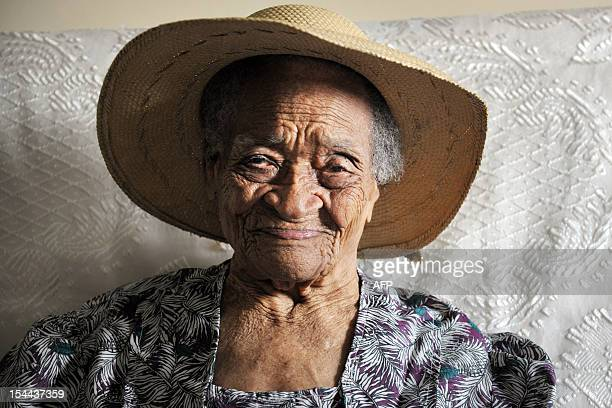 Irenise Moulonguet born as Lermain poses on October 19 2012 in Le Morne Rouge in the French overseas island of Martinique This 111yearold woman has...