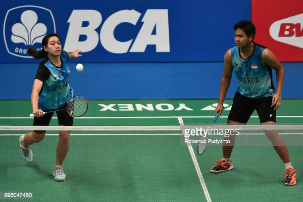 Irfan Fadhilah and Weni Anggraini of Indonesia compete against Akbar Bintang Cahyono and Winny Oktavina Kandow of Indonesia during their...