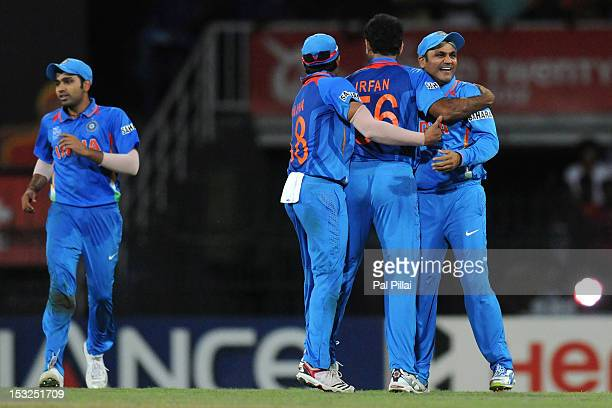 Irfan Pathan of India celebrates the wicket of Jaques Kallis of South Africa with teammates Virender Sehwag and Suresh Raina during the ICC World...