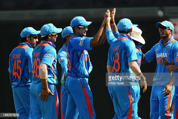 Irfan Pathan of India celebrates with team mates after catching Ricky Ponting of Australia during game seven of the One Day International series...