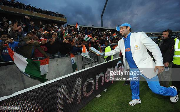 Irfan Pathan of India plays with the crowd as he pretends to hand them the trophy as he celebrates victory with the Champions Trophy during the ICC...