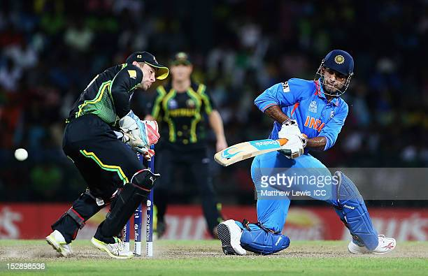 Irfan Pathan of India reverse sweeps the ball towards the boundary as Matthew Wade of Australia looks on during the ICC World Twenty20 2012 Super...