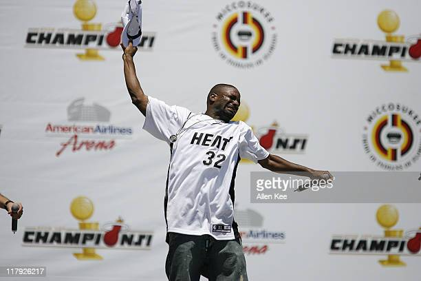 DJ Irie of the Miami Heat celebrates during the victory parade and celebration at American Airlines Arena on June 23 2006 in Miami Florida
