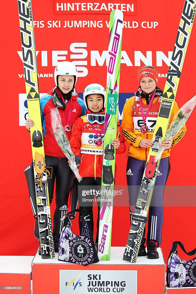 Irina Avvakumova of Russia Sara Takanashi of Japan and Carina Vogt of Germany pose during the winners' ceremony at the Ladies Ski Jumping HS 108...
