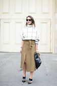 Irina Lakicevic poses wearing a Tod's top and Cline bag and skirt on September 24 2014 in Paris France