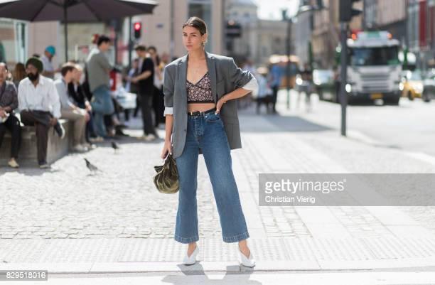 Irina Lakicevic wearing croped flared denim jeans blazer outside Baum Und Pferdgarten on August 10 2017 in Copenhagen Denmark