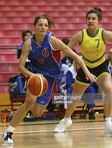 Irina Ryukhina of Russia drives to the basket against Renae Camino of Australia at the 2005 International Sports Invitational at the Peterson Gym on...