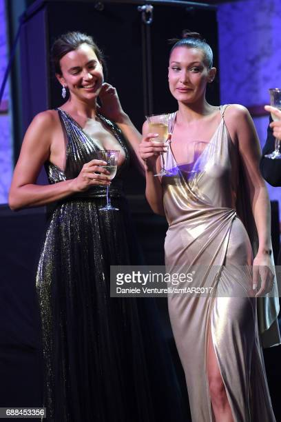 Irina Shayk and Bella Hadid attend the amfAR Gala Cannes 2017 at Hotel du CapEdenRoc on May 25 2017 in Cap d'Antibes France