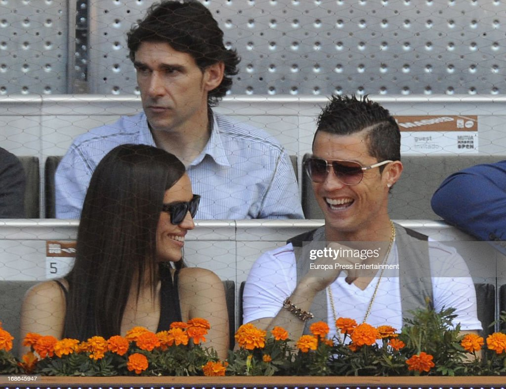 Irina Shayk and <a gi-track='captionPersonalityLinkClicked' href=/galleries/search?phrase=Cristiano+Ronaldo+-+Soccer+Player&family=editorial&specificpeople=162689 ng-click='$event.stopPropagation()'>Cristiano Ronaldo</a> attend the Mutua Madrid Open tennis tournament at La Caja Magica on May 12, 2013 in Madrid, Spain.