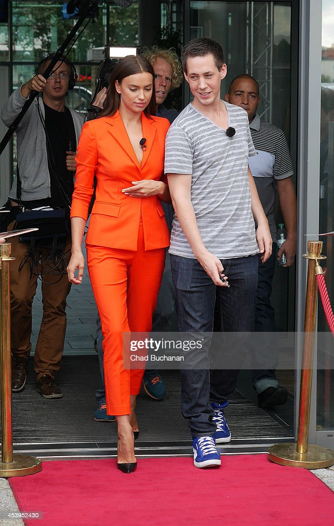 Irina Shayk (L) and her driver sighted at Sat1 television studio on August 22, 2014 in Berlin, Germany.