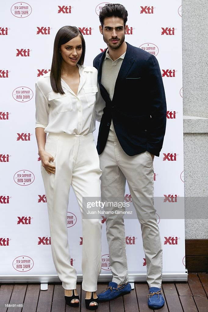 Irina Shayk (L) and Juan Betancourt attend a presentation of the new Xti shoe collection at Hospes Hotel on May 10, 2013 in Madrid, Spain.