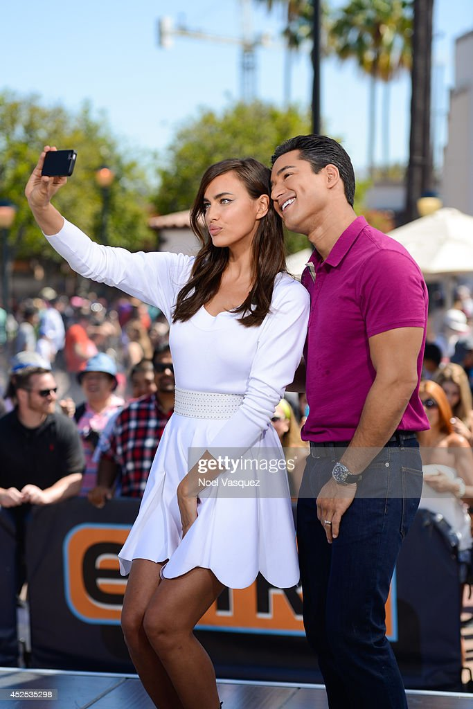 Irina Shayk (L) and <a gi-track='captionPersonalityLinkClicked' href=/galleries/search?phrase=Mario+Lopez&family=editorial&specificpeople=235992 ng-click='$event.stopPropagation()'>Mario Lopez</a> visit 'Extra' at Universal Studios Hollywood on July 22, 2014 in Universal City, California.