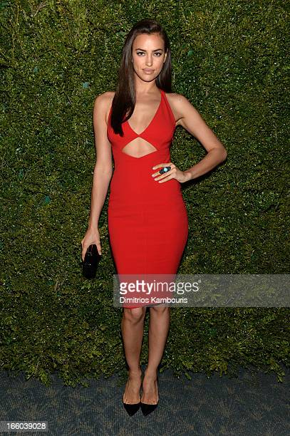 Irina Shayk attends a dinner in honor of Halle Berry as she joins Michael Kors and the United Nations World Food Programme to help fight world hunger...
