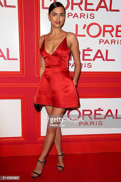 Irina Shayk attends the L'Oreal Red Obsession Party Photocall as part of the Paris Fashion Week Womenswear Fall/Winter 2016/2017 on March 8 2016 in...
