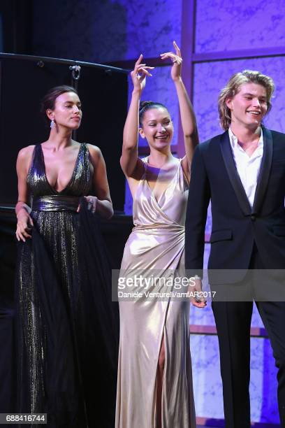 Irina Shayk Bella Hadid and Jordan Barrett are seen on stage at the amfAR Gala Cannes 2017 at Hotel du CapEdenRoc on May 25 2017 in Cap d'Antibes...