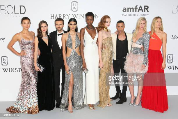 Irina Shayk Bianca Balti Neelam Gill Maria Borges Alexina Graham Olivier Rousteing Lara Stone and Doutzen Kroes arrive at the amfAR Gala Cannes 2017...