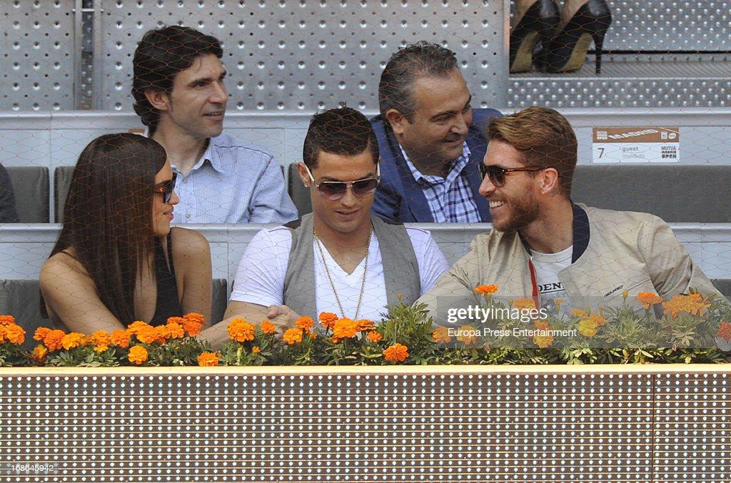 Irina Shayk, Cristiano Ronaldo and Sergio Ramos attend the Mutua Madrid Open tennis tournament at La Caja Magica on May 12, 2013 in Madrid, Spain.
