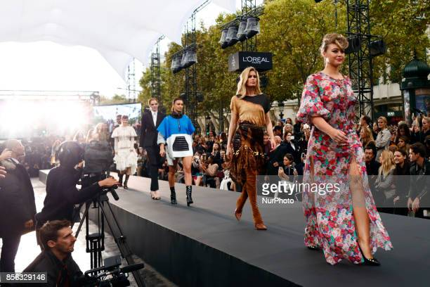 Irina Shayk Doutzen Kroes walk the runway during the Le Defile L'Oreal Paris show as part of the Paris Fashion Week Womenswear Spring/Summer 2018 at...