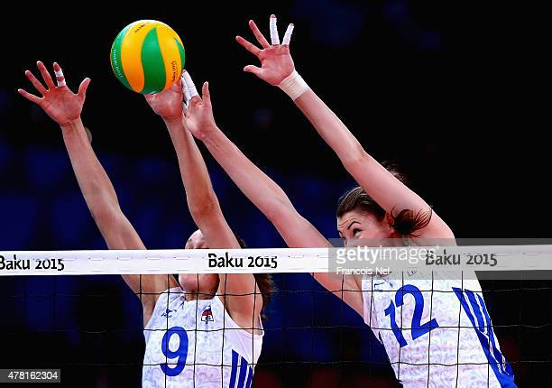 Irina Zaryazhko and Daria Pisarenko of Russia jumps at the net during the Women's Volleyball quarter final match between Turkey and Russia on day...
