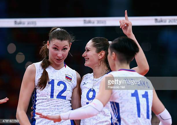 Irina Zaryazhko Daria Pisarenko and Anna Matienko of Russia celebrates a point during the Women's Volleyball quarter final match between Turkey and...