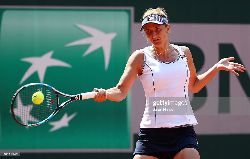 <a gi-track='captionPersonalityLinkClicked' href=/galleries/search?phrase=Irina-Camelia+Begu&family=editorial&specificpeople=7801530 ng-click='$event.stopPropagation()'>Irina-Camelia Begu</a> of Romania hits a forehand during the Ladies Singles third round match against Annika Beck of Germany on day six of the 2016 French Open at Roland Garros on May 27, 2016 in Paris, France.