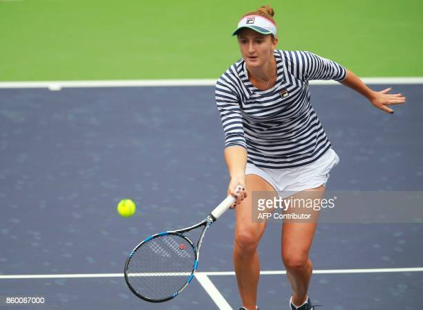 IrinaCamelia Begu of Romania hits a return against Maria Sharapova of Russia during their women's singles first round match at the WTA Tianjin Open...