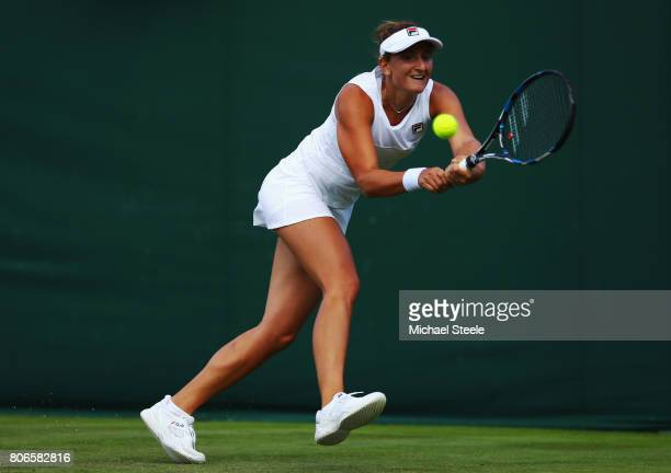 IrinaCamelia Begu of Romania plays a backhand during the Ladies Singles first round match against Naomi Broady of Great Britain on day one of the...