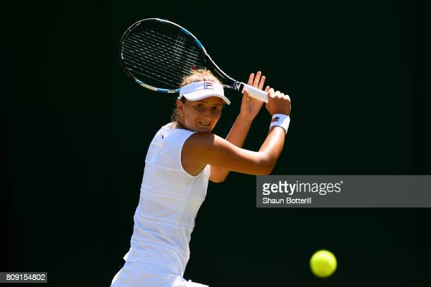 IrinaCamelia Begu of Romania plays a backhand during the Ladies Singles second round match against Ana Konjuh of Croatia on day three of the...