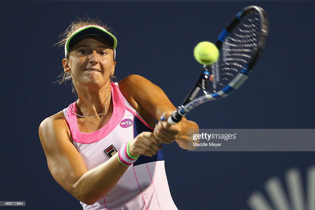 Irina-Camelia Begu of Romania returns a backhand to Lucie Safarova of Czech Republic during day 2 of the Connecticut Open at Connecticut Tennis Center at Yale on August 25, 2015 in New Haven, Connecticut.