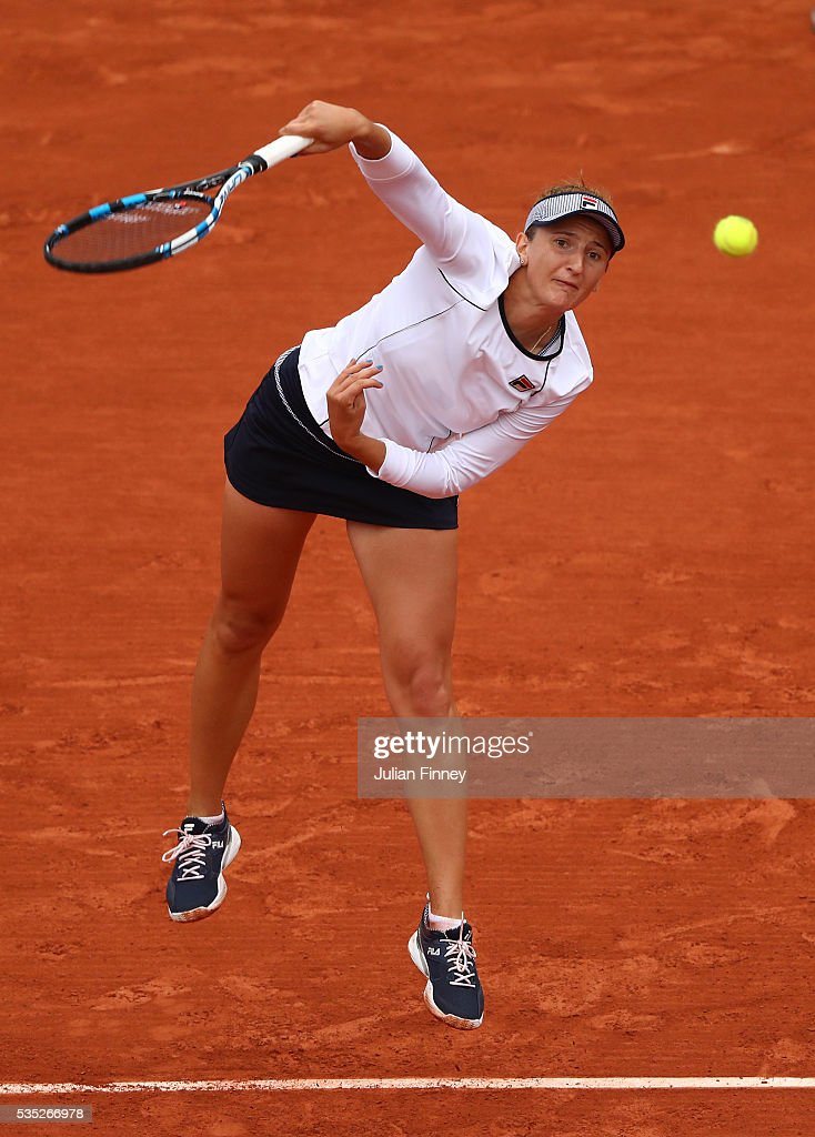 <a gi-track='captionPersonalityLinkClicked' href=/galleries/search?phrase=Irina-Camelia+Begu&family=editorial&specificpeople=7801530 ng-click='$event.stopPropagation()'>Irina-Camelia Begu</a> of Romania serves during the Ladies Singles fourth round match against Shelby Rogers of the United States on day eight of the 2016 French Open at Roland Garros on May 29, 2016 in Paris, France.