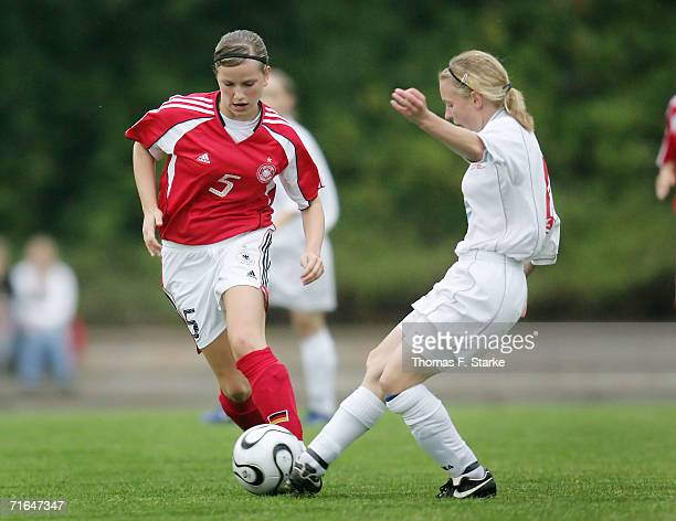 Irini Joanidou of Germany tackles for the ball with Emily Hancock of Wales during the Women's Under 15 match between Germany and Wales on August 15...