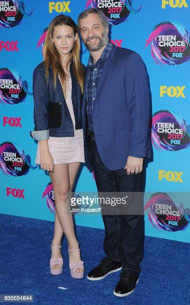 Iris Apatow and Judd Apatow arrive at the Teen Choice Awards 2017 at Galen Center on August 13 2017 in Los Angeles California