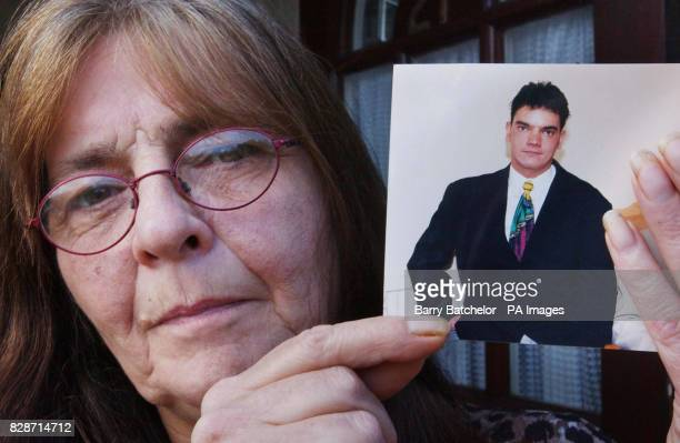 Iris Baker holds a photo of her son Nicholas Baker at her home in Oaksey Gloucestershire after the architect was jailed for 14 years in Japan today...