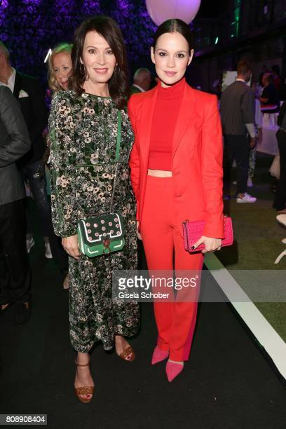 Iris Berben and Emilia Schuele during the Marc Cain Fashion Show Spring/Summer 2018 at ewerk on July 4 2017 in Berlin Germany