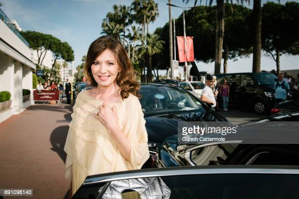 Iris Berben departs the Martinez Hotel during the 70th annual Cannes Film Festival on May 21 2017 in Cannes France