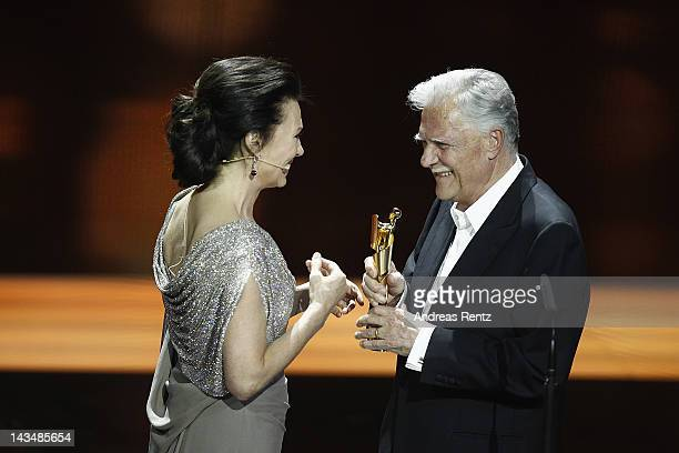 Iris Berben hands over the 'Lifetime Achievement Award' to Michael Ballhaus during the Lola German Film Award 2012 Show at FriedrichstadtPalast on...