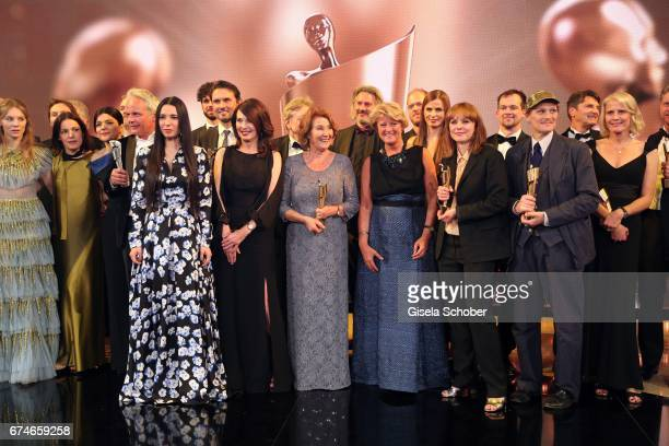 Iris Berben Monika Schindler Monika Gruetters Georg Friedrich and Maren Ade pose on stage after the Lola German Film Award show at Messe Berlin on...