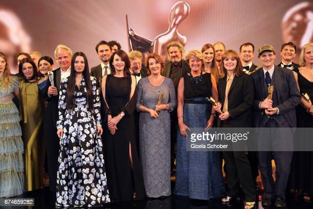 Iris Berben Monika Schindler Monika Gruetters Georg Friedrich Maren Ade pose on stage after the Lola German Film Award show at Messe Berlin on April...