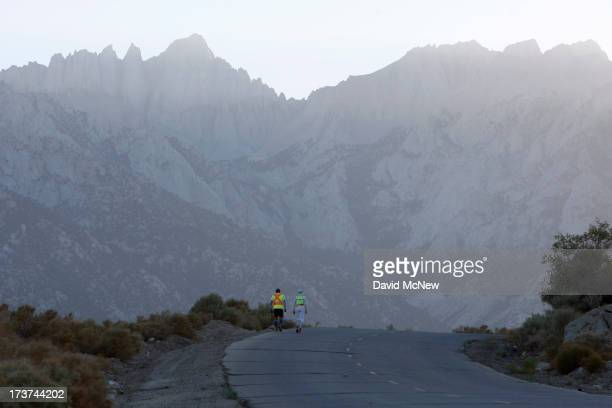 Iris CooperImhof of Canada walks toward Mount Whitney during the ascent of Whitney Portal Road to the finish of the AdventurCORPS Badwater 135...