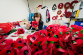 Iris Kellett assembles 'A spray' of the iconic red emblem of the British Legion's annual poppy appeal at the company headquarters in Richmond on...