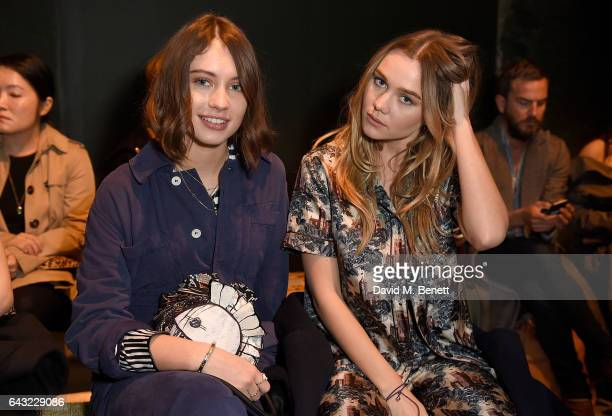Iris Law and Immy Waterhouse wearing Burberry attend the Burberry February 2017 Show during London Fashion Week February 2017 at Makers House on...