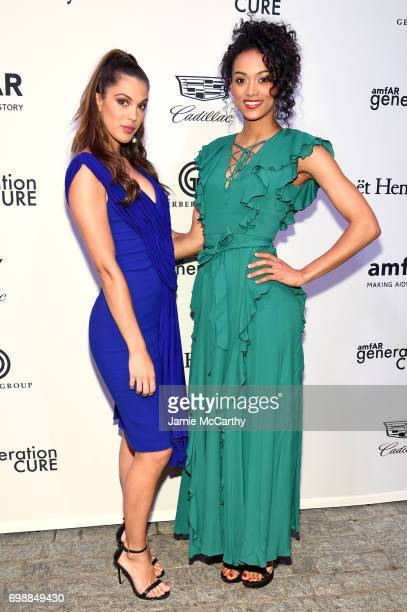Iris Mittenaere and Kara McCullough attend the amfAR generationCURE Solstice 2017 at Mr Purple on June 20 2017 in New York City